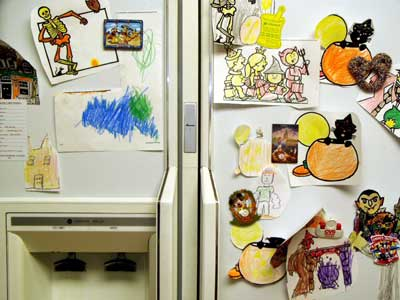 drawings hung on refrigerator