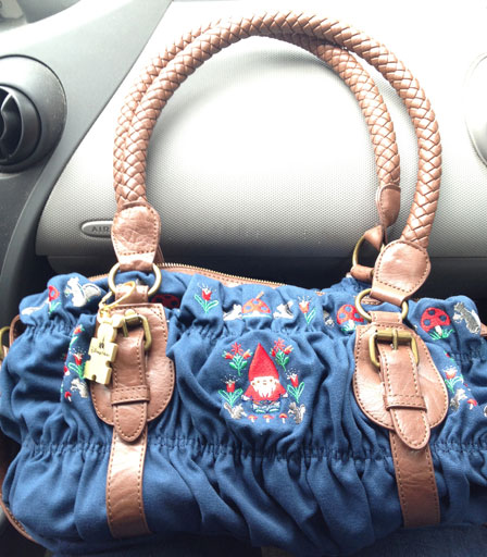 Expertly styled on my lap in my car. I have matching keychains, one for each bag.