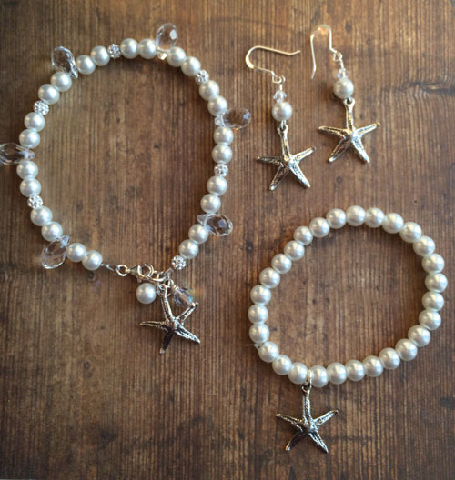 Two bracelets and a pair of earrings.